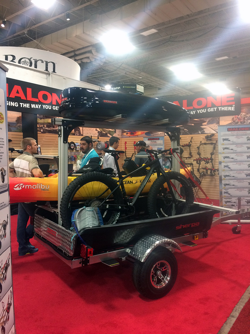 Malone Trailers has created an intriguing trailer option with a bed that's capable of carrying an adventure motorcycle and any other outdoors gear.